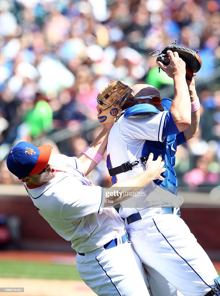 <a gi-track='captionPersonalityLinkClicked' href=/galleries/search?phrase=John+Buck&family=editorial&specificpeople=213730 ng-click='$event.stopPropagation()'>John Buck</a> #44 of the New York Mets makes the catch as he and teammate <a gi-track='captionPersonalityLinkClicked' href=/galleries/search?phrase=David+Wright+-+Baseball+Player&family=editorial&specificpeople=209172 ng-click='$event.stopPropagation()'>David Wright</a> #5 collide in the fifth inning against the Pittsburgh Pirates on May 12, 2013 at Citi Field in the Flushing neighborhood of the Queens borough of New York City.