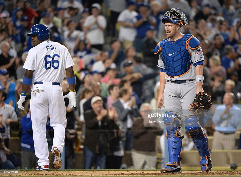 <a gi-track='captionPersonalityLinkClicked' href=/galleries/search?phrase=John+Buck&family=editorial&specificpeople=213730 ng-click='$event.stopPropagation()'>John Buck</a> #44 of the New York Mets reacts after a <a gi-track='captionPersonalityLinkClicked' href=/galleries/search?phrase=Yasiel+Puig&family=editorial&specificpeople=10484087 ng-click='$event.stopPropagation()'>Yasiel Puig</a> #66 of the Los Angeles Dodgers sacrifice fly to score Adrian Gonzalez #23 for a 3-2 lead during the sixth inning at Dodger Stadium on August 12, 2013 in Los Angeles, California.