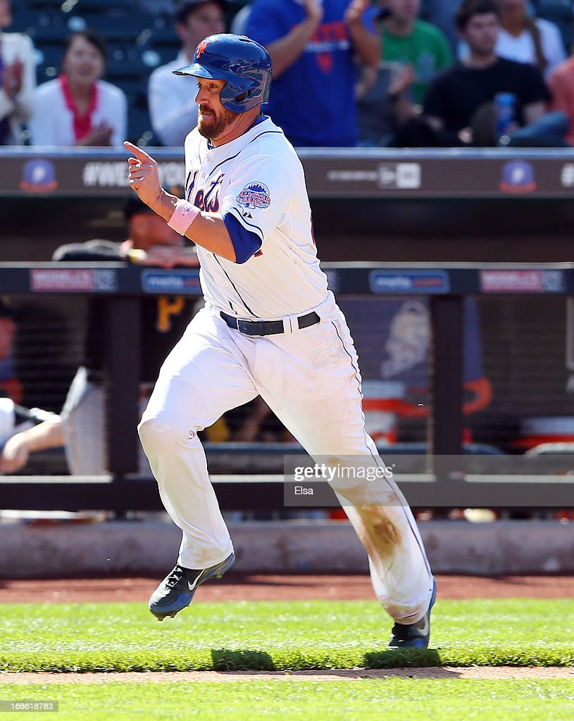 <a gi-track='captionPersonalityLinkClicked' href=/galleries/search?phrase=John+Buck&family=editorial&specificpeople=213730 ng-click='$event.stopPropagation()'>John Buck</a> #44 of the New York Mets scores a run in the seventh inning against the New York Mets on May 12, 2013 at Citi Field in the Flushing neighborhood of the Queens borough of New York City.