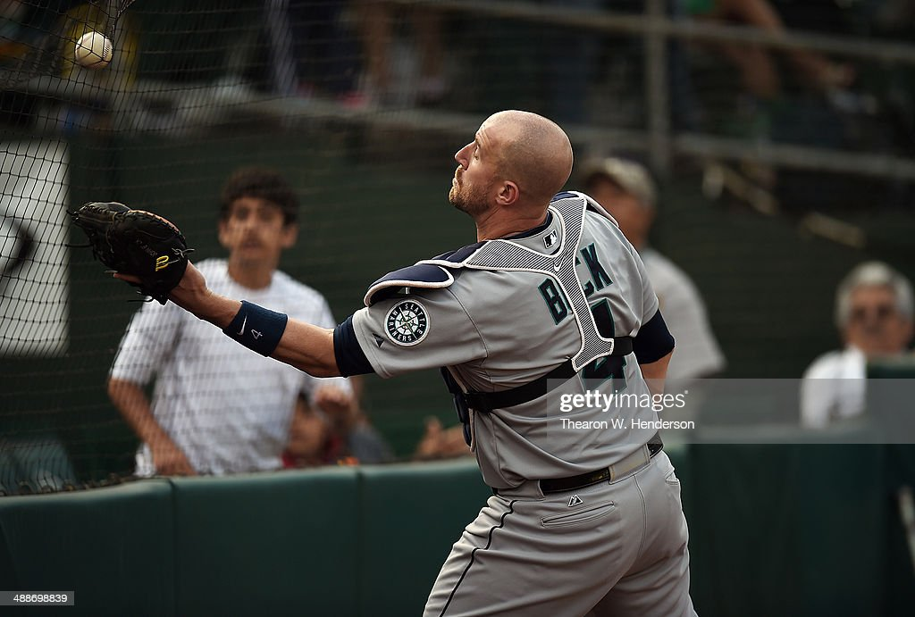 <a gi-track='captionPersonalityLinkClicked' href=/galleries/search?phrase=John+Buck&family=editorial&specificpeople=213730 ng-click='$event.stopPropagation()'>John Buck</a> #4 of the Seattle Mariners is on the wrong side of the net to catch this foul pop-up off the bat of Jed Lowrie #8 of the Oakland Athletics (not pictured) in the bottom of the fifth inning during game two of a doubleheader at O.co Coliseum on May 7, 2014 in Oakland, California. The Athletics won the game 2-0.