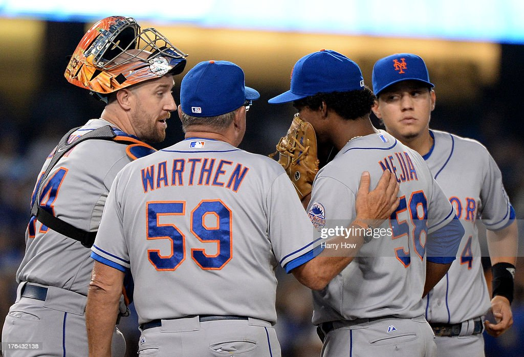 <a gi-track='captionPersonalityLinkClicked' href=/galleries/search?phrase=John+Buck&family=editorial&specificpeople=213730 ng-click='$event.stopPropagation()'>John Buck</a> #44, pitching coach Dan Warthen #59 and <a gi-track='captionPersonalityLinkClicked' href=/galleries/search?phrase=Wilmer+Flores&family=editorial&specificpeople=5970686 ng-click='$event.stopPropagation()'>Wilmer Flores</a> #4 of the New York Mets speak to Jenrry Mejia #58 of the New York Mets on the mound after the Los Angeles Dodgers tie the score 2-2 during the sixth inning at Dodger Stadium on August 12, 2013 in Los Angeles, California.