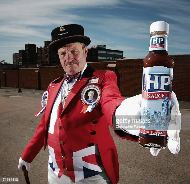 John Bull alias Ray Egan poses with a bottle of HP sauce as workers from Birmingham's HP Sauce company protest outside the factory against closure on...
