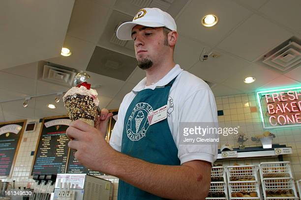 AURORA CO 6/19/03 John Burrall<cq> employee at the twoweekold Marble Slab Creamery<cq> in the Pioneer Hills Shopping Center on South Parker Road near...