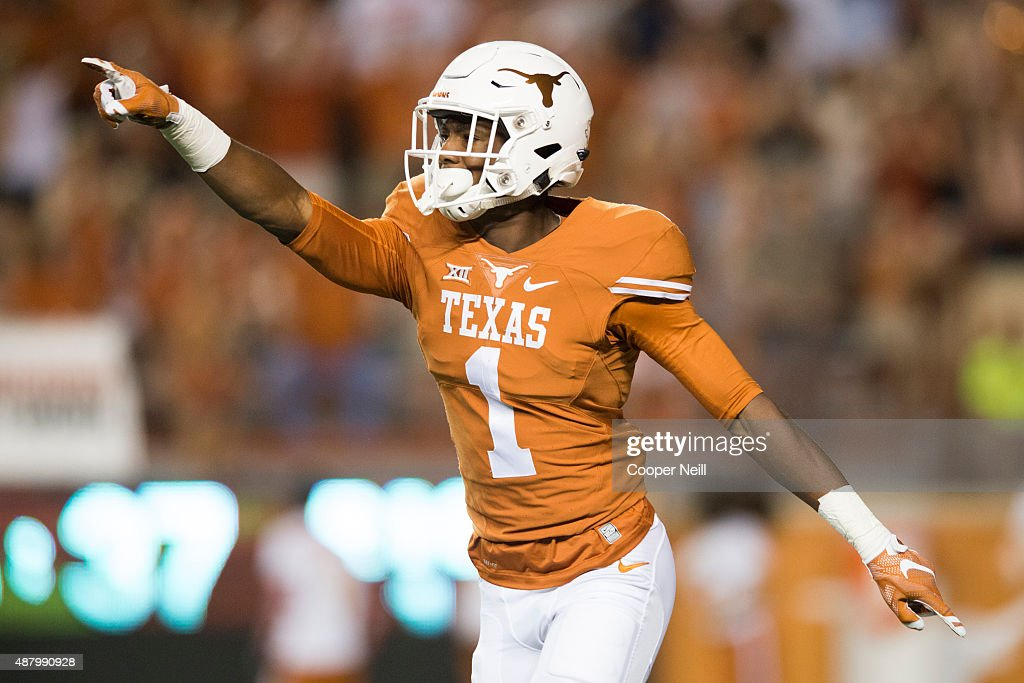 John Burt of the Texas Longhorns celebrates after scoring on a 69 yard touchdown pass against the Rice Owls during the third quarter on September 12...