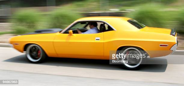 John Buscema president of XV Motorsports of Irvington New York drives a 1970 Dodge Challenger XV001 vintage muscle car one of several that his...