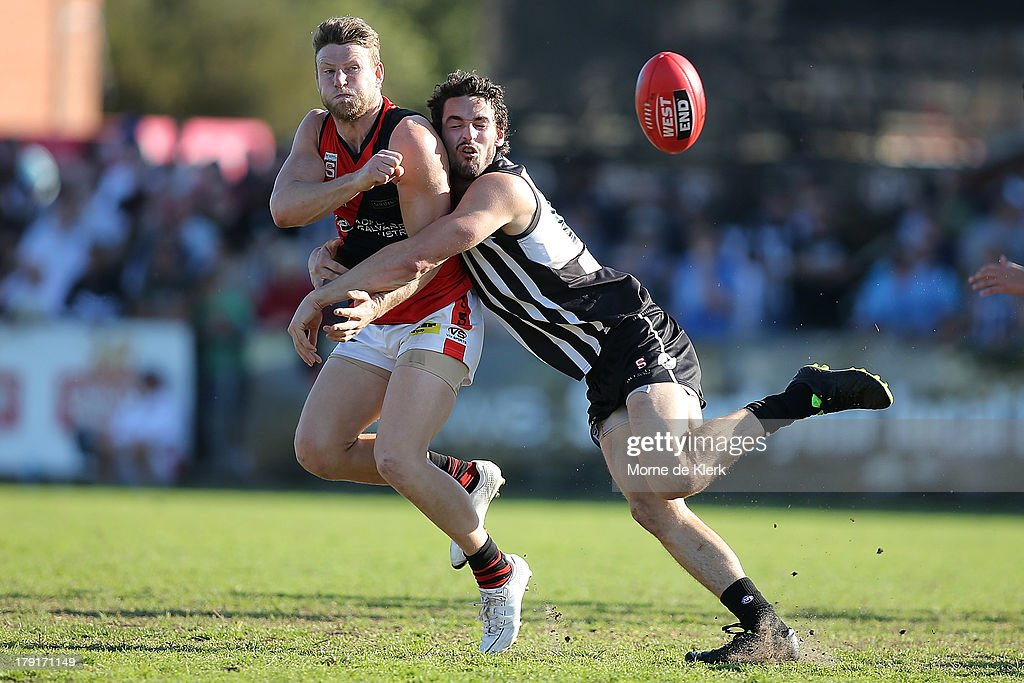 John Butcher of the Magpies lays a tackle during the round 22 SANFL match between the Port Adelaide Magpies and the West Adelaide Bloods at Alberton Oval on September 1, 2013 in Adelaide, Australia.