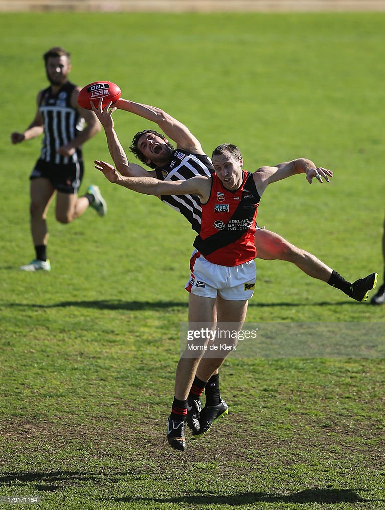 John Butcher of the Magpies takes a mark during the round 22 SANFL match between the Port Adelaide Magpies and the West Adelaide Bloods at Alberton Oval on September 1, 2013 in Adelaide, Australia.