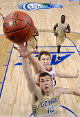 John Cain Carney of the Boston College Eagles battles Travis Jorgenson of the Georgia Tech Yellow Jackets for a rebound during a first round game of...