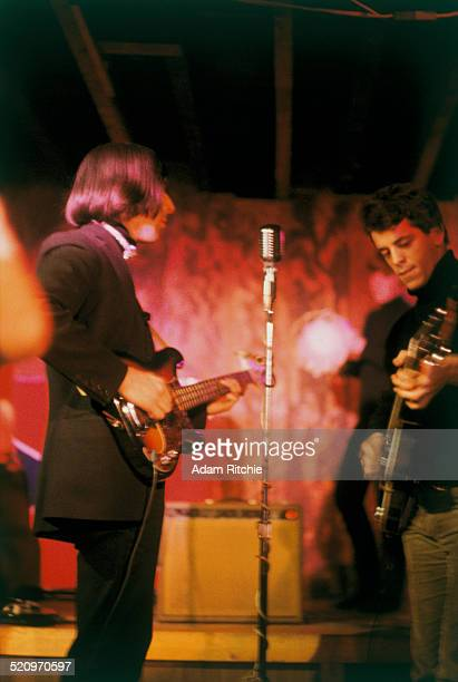 John Cale and Lou Reed of the Velvet Underground perform on stage at the Cafe Bizarre New York December 1965