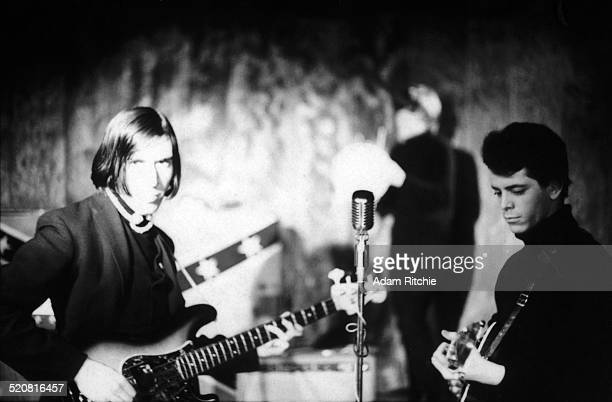 John Cale and Lou Reed of the Velvet Underground performs on stage at the Cafe Bizarre New York December 1965
