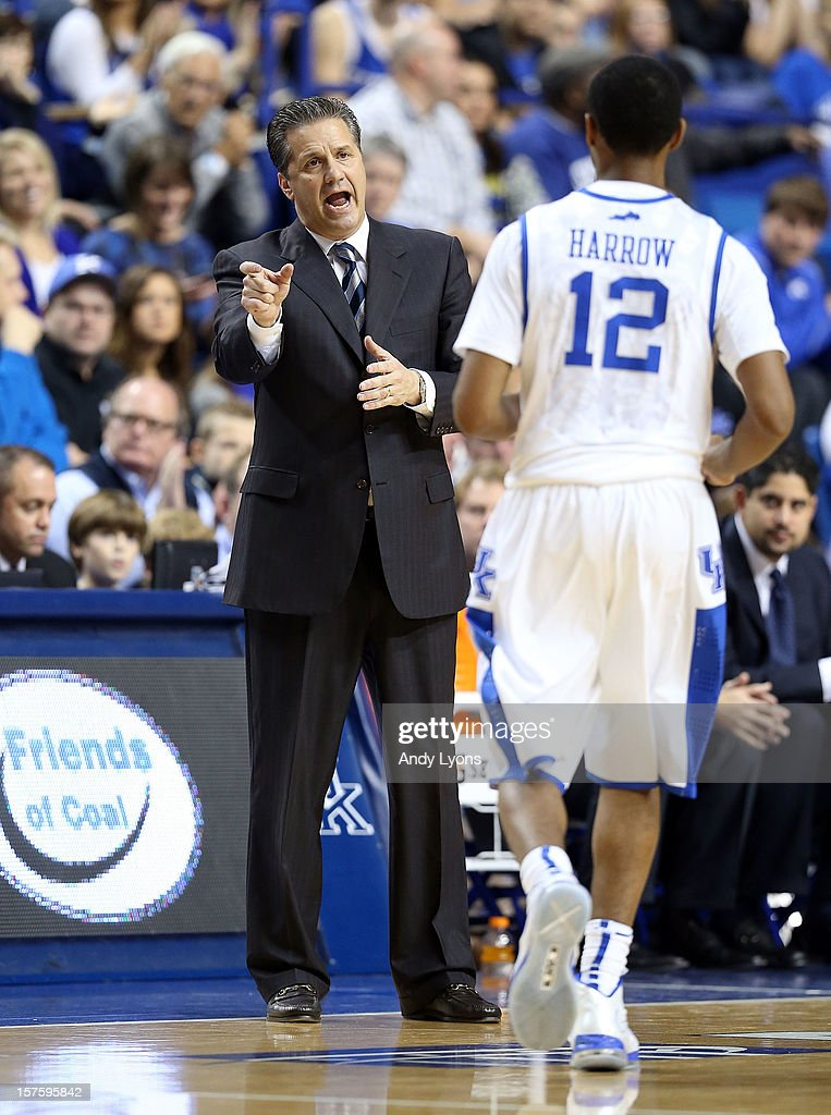 John Calipari the head coach of the Kentucky Wildcats gives instructions to Ryan Harrow #12 during the game against the Samford Bulldogs at Rupp Arena on December 4, 2012 in Lexington, Kentucky.