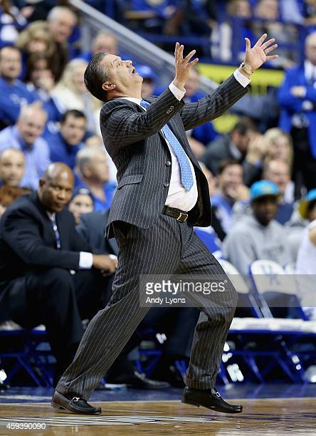 John Calipari the head coach of the Kentucky Wildcats reacts to a call during the game against the Boston Terriers at Rupp Arena on November 21 2014...