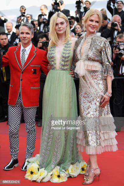 John Cameron Mitchell Elle Fanning and Nicole Kidman depart after the 'How To Talk To Girls At Parties' screening during the 70th annual Cannes Film...