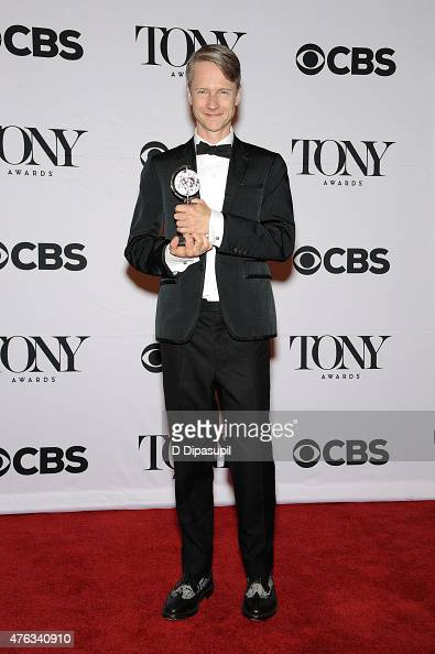 John Cameron Mitchell poses in the press room during the American Theatre Wing's 69th Annual Tony Awards at Radio City Music Hall on June 7 2015 in...