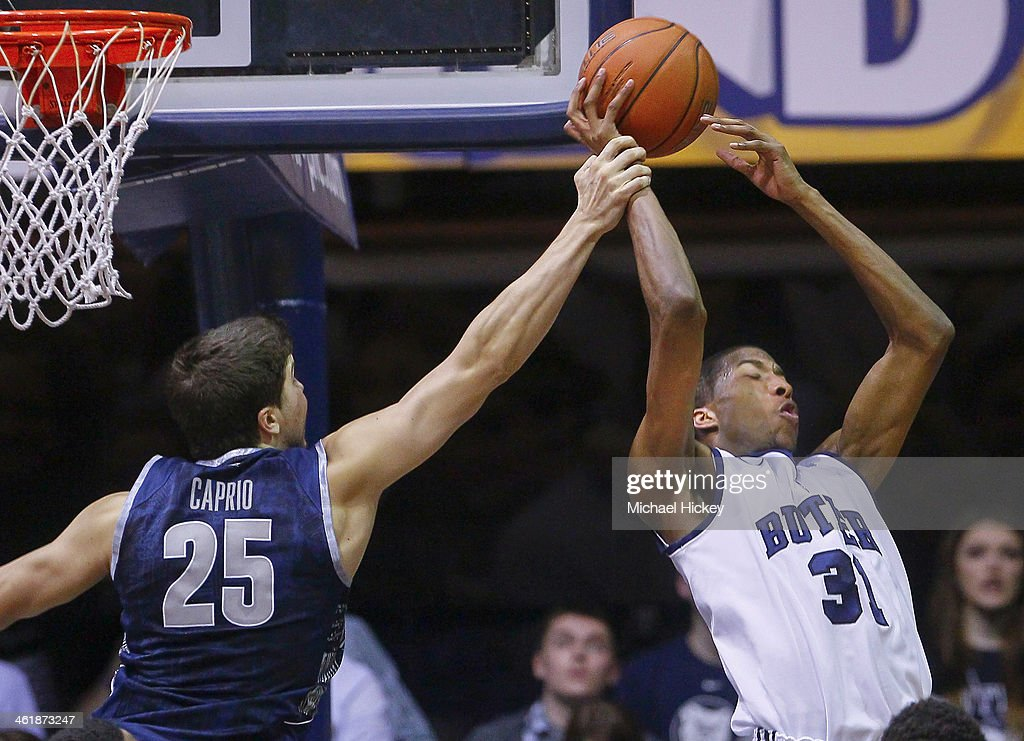 John Caprio #25 of the Georgetown Hoyas grabs the arm of Kameron Woods #31 of the Butler Bulldogs at Hinkle Fieldhouse on January 11, 2014 in Indianapolis, Indiana. Georgetown defeated Butler 70-67.