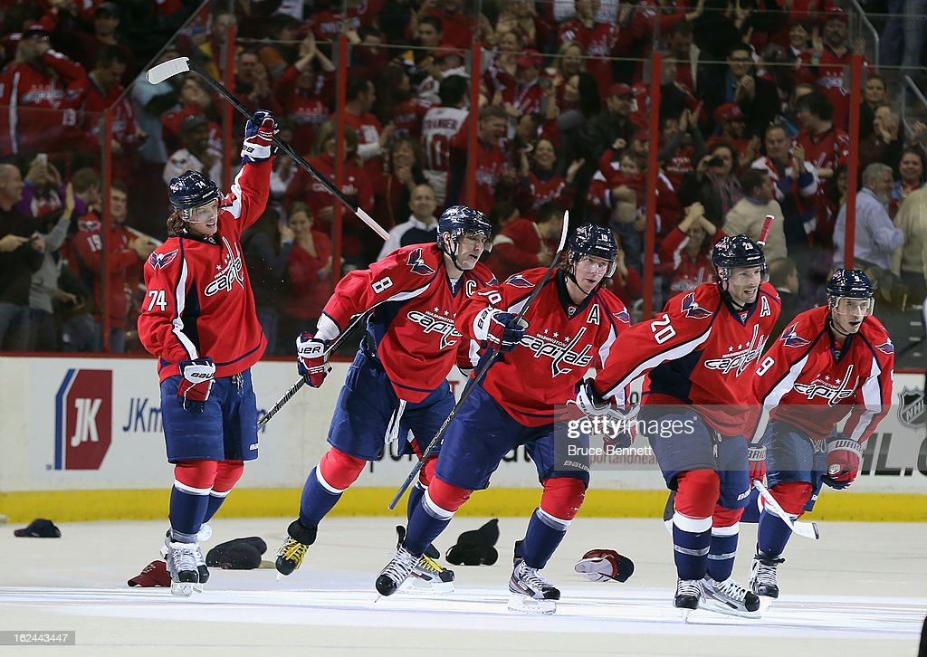 <a gi-track='captionPersonalityLinkClicked' href=/galleries/search?phrase=John+Carlson+-+Ice+Hockey+Player&family=editorial&specificpeople=7983228 ng-click='$event.stopPropagation()'>John Carlson</a> #74, Alex Ovechkin #8, Nicklas Backstrom #19, <a gi-track='captionPersonalityLinkClicked' href=/galleries/search?phrase=Troy+Brouwer&family=editorial&specificpeople=4155305 ng-click='$event.stopPropagation()'>Troy Brouwer</a> #20 and <a gi-track='captionPersonalityLinkClicked' href=/galleries/search?phrase=Mike+Ribeiro&family=editorial&specificpeople=203275 ng-click='$event.stopPropagation()'>Mike Ribeiro</a> #9 of the Washington Capitals leave the ice after Ovechkin's hat trick in the third period against the New Jersey Devils at the Verizon Center on February 23, 2013 in Washington, DC. The Capitals defeated the Devils 5-1.