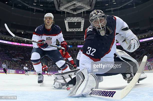US John Carlson and goalkeeper Jonathan Quick look on during the Men's Ice Hockey Semifinal match between the USA and Canada at the Bolshoy Ice Dome...