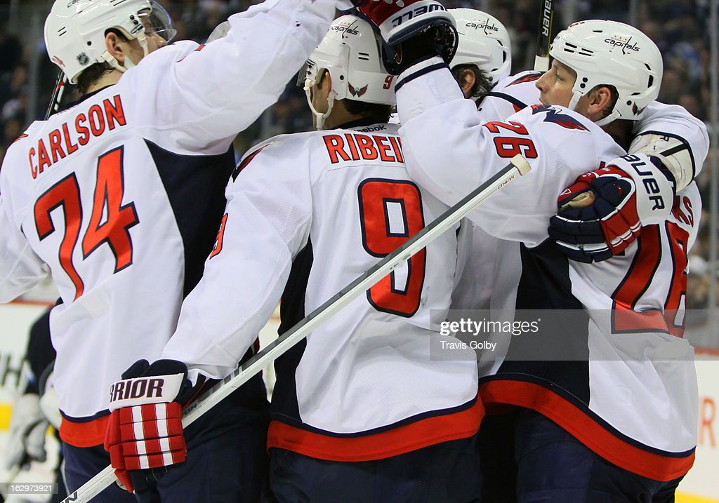 John Carlson #74, <a gi-track='captionPersonalityLinkClicked' href=/galleries/search?phrase=Mike+Ribeiro&family=editorial&specificpeople=203275 ng-click='$event.stopPropagation()'>Mike Ribeiro</a> #9, Alex Ovechkin #8 and <a gi-track='captionPersonalityLinkClicked' href=/galleries/search?phrase=Matt+Hendricks&family=editorial&specificpeople=4537275 ng-click='$event.stopPropagation()'>Matt Hendricks</a> #26 of the Washington Capitals celebrate a second period goal against the Winnipeg Jets at the MTS Centre on March 2, 2013 in Winnipeg, Manitoba, Canada.