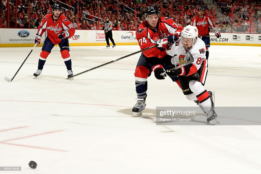 John Carlson #74 of the Washington Capitals and <a gi-track='captionPersonalityLinkClicked' href=/galleries/search?phrase=Cory+Conacher&family=editorial&specificpeople=8312407 ng-click='$event.stopPropagation()'>Cory Conacher</a> #89 of the Ottawa Senators fight for the puck during an NHL game at Verizon Center on April 25, 2013 in Washington, DC.