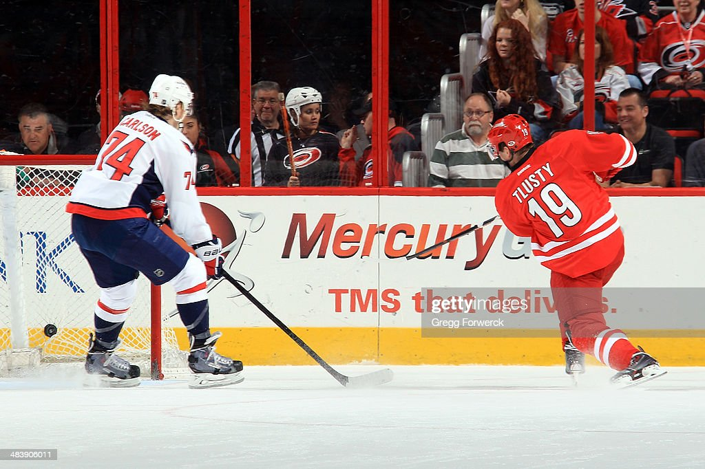 John Carlson #74 of the Washington Capitals cannot prevent a goal scored by <a gi-track='captionPersonalityLinkClicked' href=/galleries/search?phrase=Jiri+Tlusty&family=editorial&specificpeople=543236 ng-click='$event.stopPropagation()'>Jiri Tlusty</a> #19 of the Carolina Hurricanes in the second period of their NHL game at PNC Arena on April 10, 2014 in Raleigh, North Carolina.