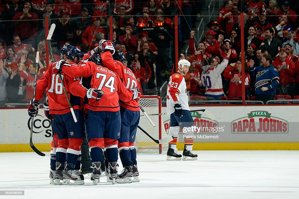 John Carlson #74 of the Washington Capitals celebrates after scoring a goal in the first period of an NHL game against the Florida Panthers at Verizon Center on March 7, 2013 in Washington, DC.