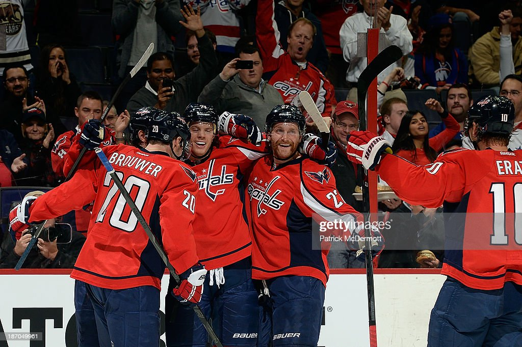 John Carlson #74 of the Washington Capitals celebrates after scoring a goal in the second period of an NHL game against the New York Islanders at Verizon Center on November 5, 2013 in Washington, DC.
