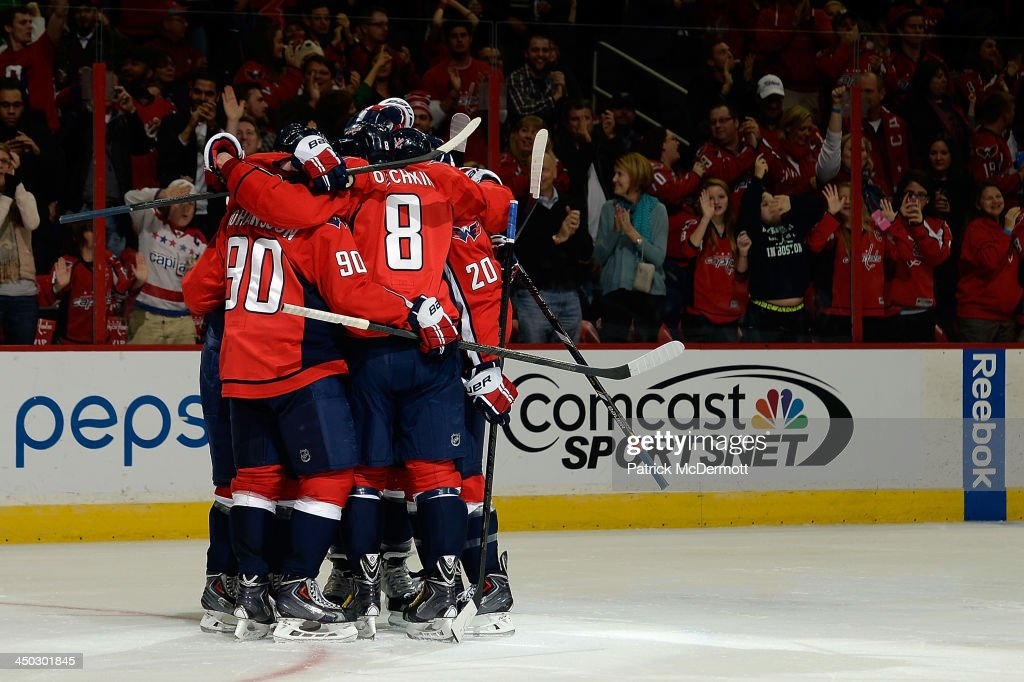 John Carlson #74 of the Washington Capitals celebrates after scoring a goal in the second period during an NHL game against the St. Louis Blues at Verizon Center on November 17, 2013 in Washington, DC.