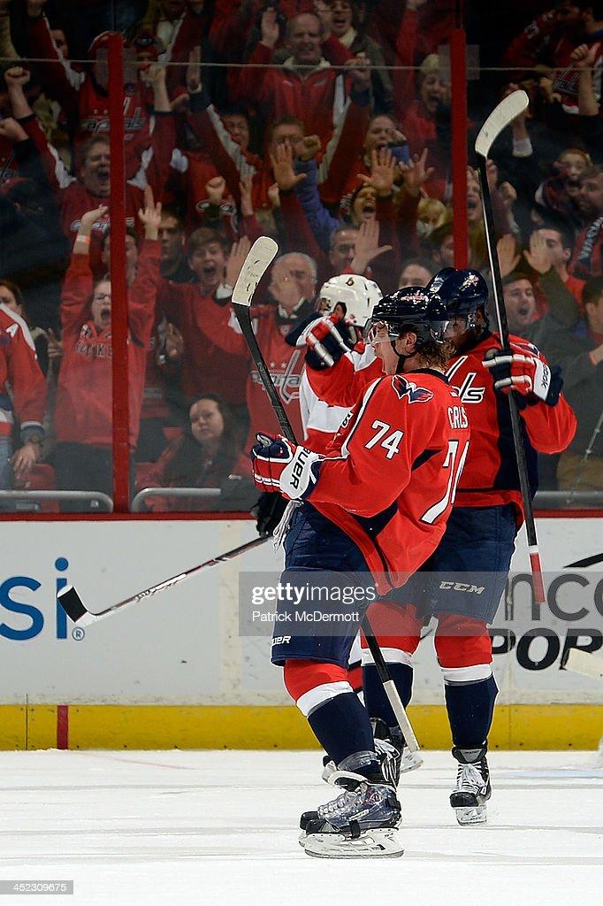 John Carlson #74 of the Washington Capitals celebrates after scoring a goal in the third period of an NHL game against the Ottawa Senators at Verizon Center on November 27, 2013 in Washington, DC.