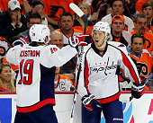 John Carlson of the Washington Capitals celebrates his goal with teammate Nicklas Backstrom in the third period against the Philadelphia Flyers in...
