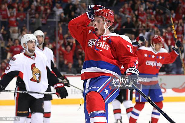 John Carlson of the Washington Capitals celebrates his second period goal against the Ottawa Senators at Verizon Center on December 16 2015 in...
