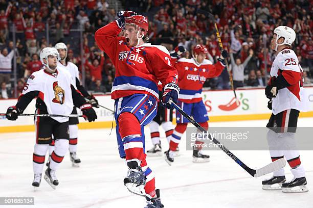 John Carlson of the Washington Capitals celebrates his second period goal against the Ottawa Senators at Verizon Center on December 16 2015 in...
