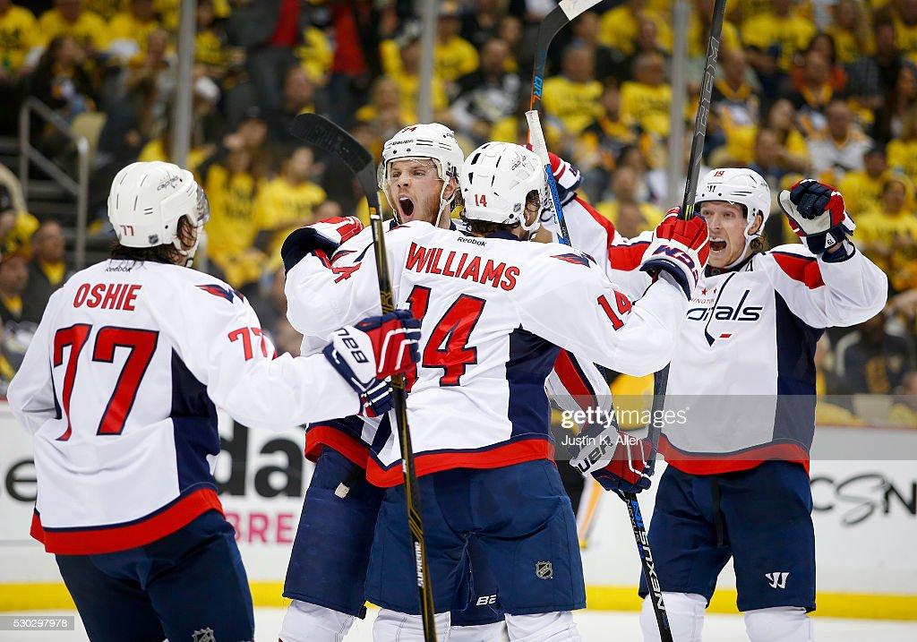 John Carlson #74 of the Washington Capitals celebrates his third period goal against the Pittsburgh Penguins in Game Six of the Eastern Conference Second Round during the 2016 NHL Stanley Cup Playoffs at Consol Energy Center on May 10, 2016 in Pittsburgh, Pennsylvania.
