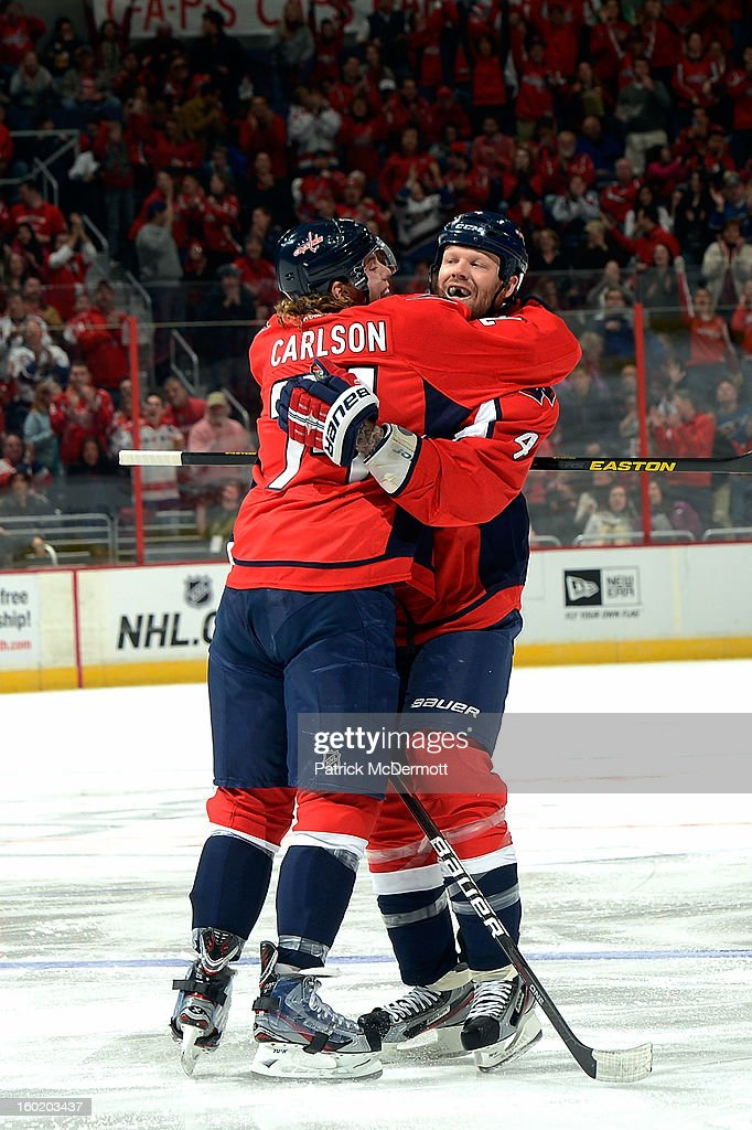 John Carlson #74 of the Washington Capitals celebrates with <a gi-track='captionPersonalityLinkClicked' href=/galleries/search?phrase=John+Erskine&family=editorial&specificpeople=215268 ng-click='$event.stopPropagation()'>John Erskine</a> #4 after Erskine's goal in the second period of an NHL hockey game against the Buffalo Sabres at Verizon Center on January 27, 2013 in Washington, DC.
