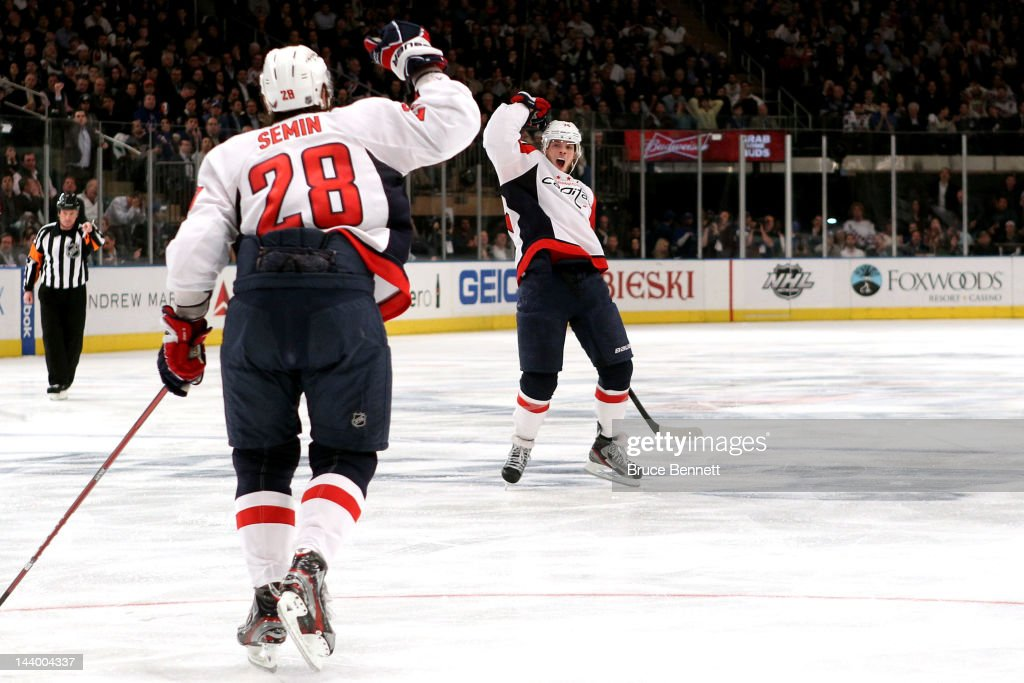 John Carlson #74 of the Washington Capitals celebrates with teammate <a gi-track='captionPersonalityLinkClicked' href=/galleries/search?phrase=Alexander+Semin&family=editorial&specificpeople=206654 ng-click='$event.stopPropagation()'>Alexander Semin</a> #28 after scoring a goal in the third period against Henrik Lundqvist #30 of the New York Rangers in Game Five of the Eastern Conference Semifinals during the 2012 NHL Stanley Cup Playoffs at Madison Square Garden on May 7, 2012 in New York City.
