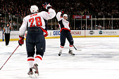 John Carlson of the Washington Capitals celebrates with teammate Alexander Semin after scoring a goal in the third period against Henrik Lundqvist of...