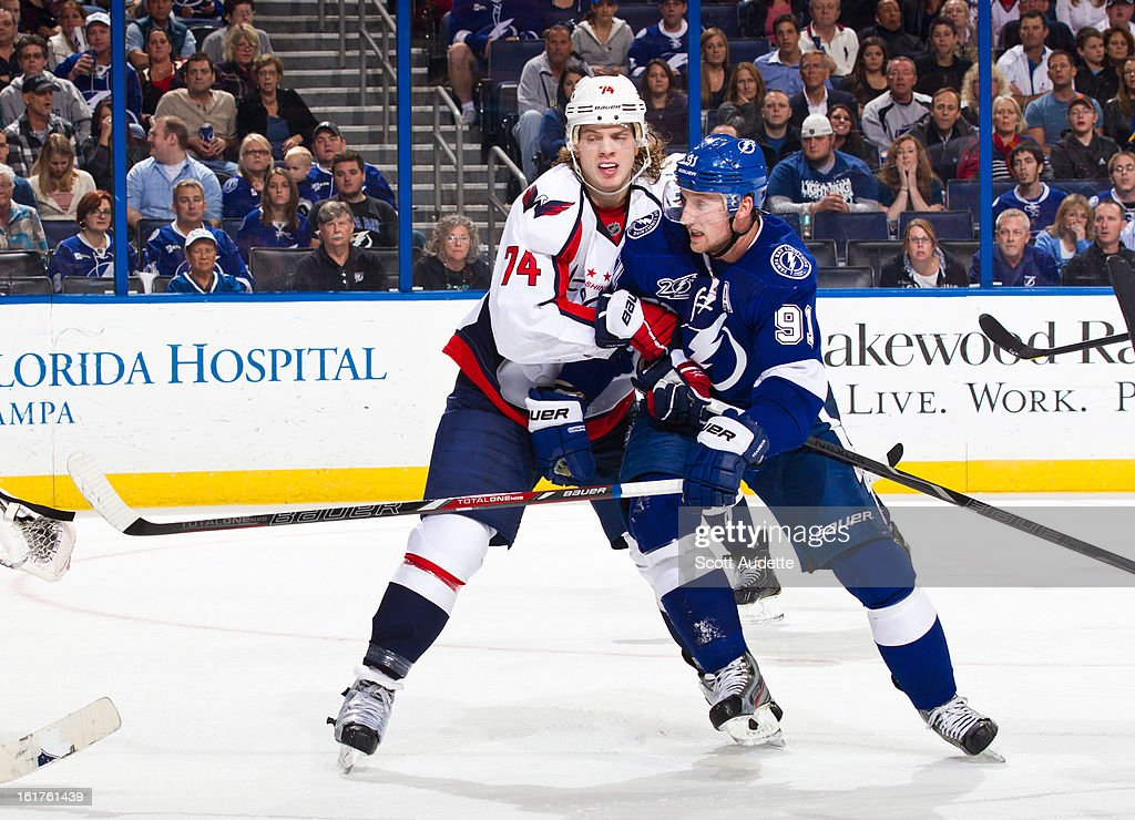 John Carlson #74 of the Washington Capitals checks Steven Stamkos #91 of the Tampa Bay Lightning during the third period of the game at the Tampa Bay Times Forum on February 14, 2013 in Tampa, Florida.