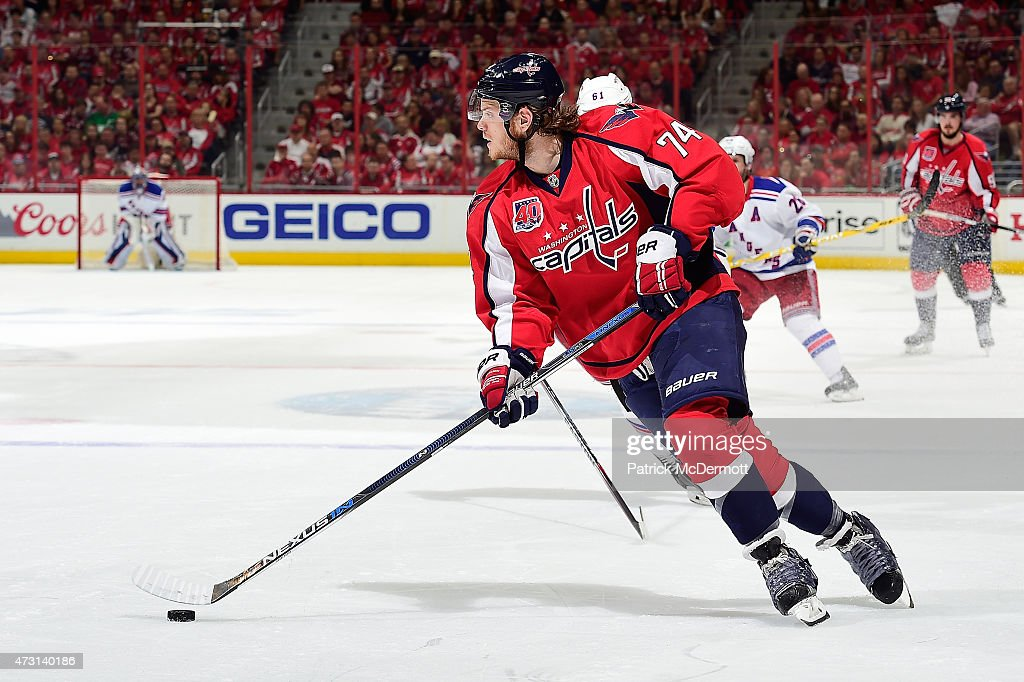 <a gi-track='captionPersonalityLinkClicked' href=/galleries/search?phrase=John+Carlson+-+Ice+Hockey+Player&family=editorial&specificpeople=7983228 ng-click='$event.stopPropagation()'>John Carlson</a> #74 of the Washington Capitals controls the puck against the New York Rangers during the first period in Game Six of the Eastern Conference Semifinals during the 2015 NHL Stanley Cup Playoffs at Verizon Center on May 10, 2015 in Washington, DC.