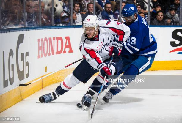 John Carlson of the Washington Capitals skates against Nazem Kadri of the Toronto Maple Leafs during the third period in Game Six of the Eastern...