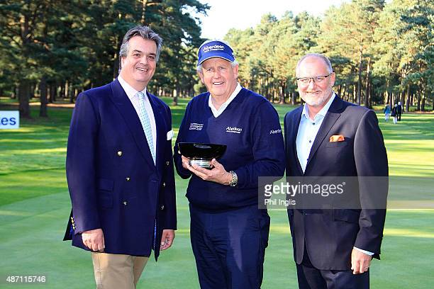 John Carter CEO Travis Perkins and The Duke of Bedford present the trophy to Colin Montgomerie of Scotland after the final round of the Travis...