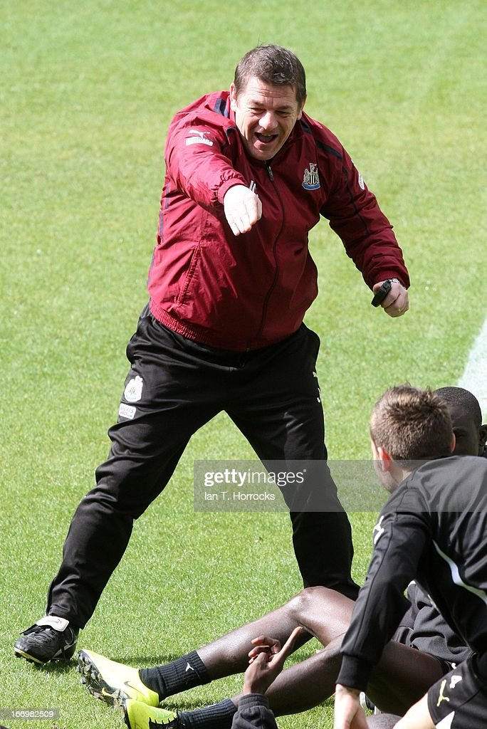 John Carver gestures during a Newcastle United training session at St James' Park on April 19, in Newcastle upon Tyne, England.