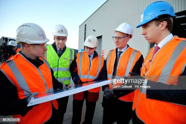 John Castle the senior area engineer for London shows HS2 plans to David Bell of JCB Robert Goodwill the Secretary of State for Transport Lord...