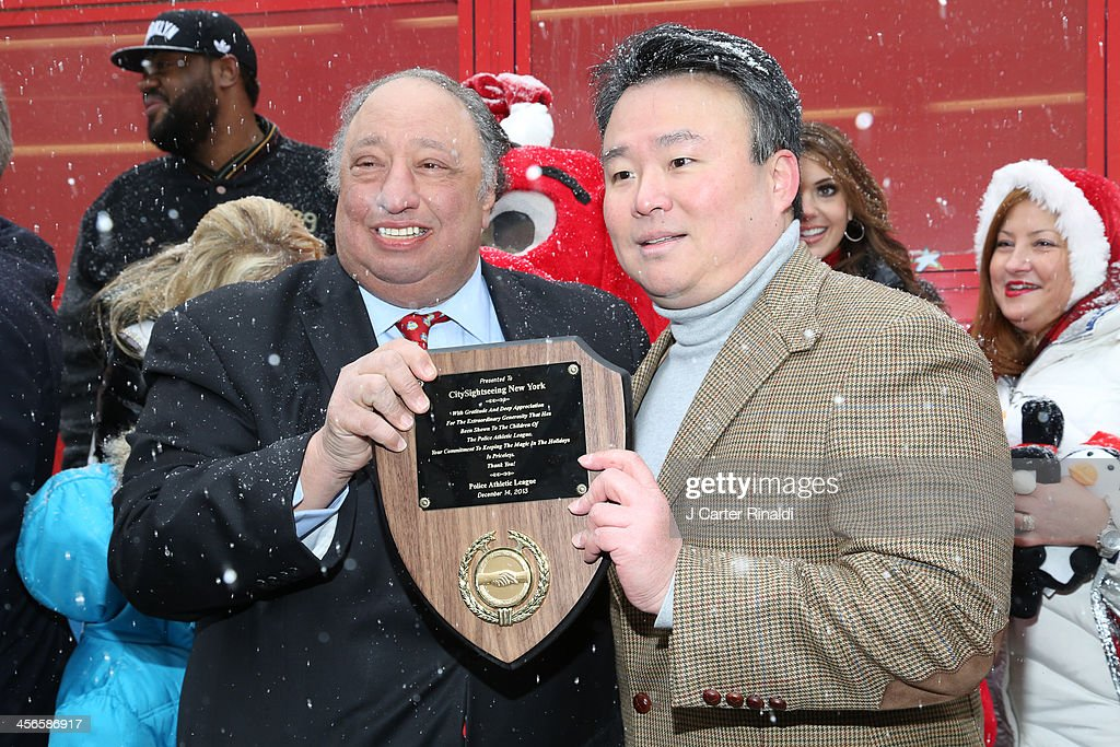 John Catsimatidis and David W. Chien attends CitySightseeing New York 2013 holiday toy drive at PAL's Harlem Center on December 14, 2013 in New York City.