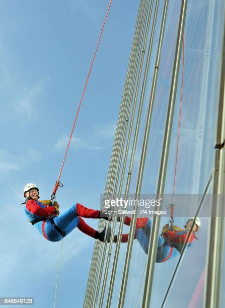 John Caudwell wears a Spiderman suit as he abseils down from the top of the Shard in central London for charity He is one of around 40 people to...