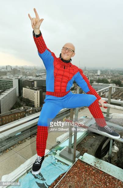 John Caudwell wears a Spiderman suit before he abseiled down from the top of the Shard in central London for charity He is one of around 40 people to...
