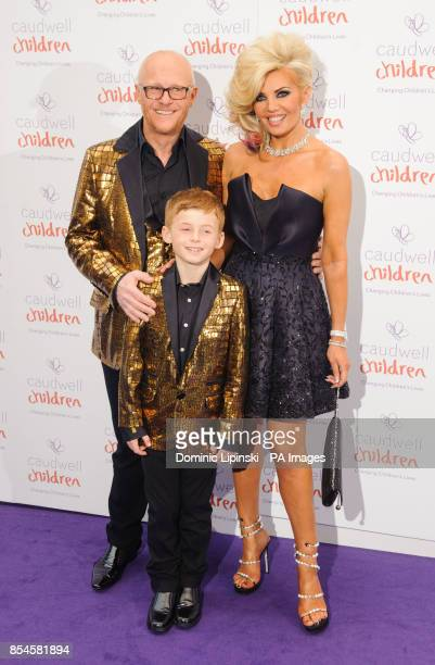 John Caudwell with partner Claire Johnson and son Jacobi arriving at the Caudwell Children Butterfly Ball at the Grosvenor House hotel in central...