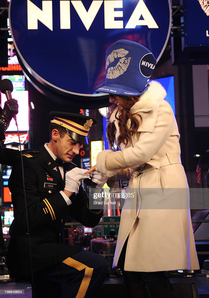John Cebak surprised his girlfriend Sonja Babic with a proposal on the NIVEA Kiss Stage in Times Square on New Year's Eve 2013 on December 31, 2012 in New York City.