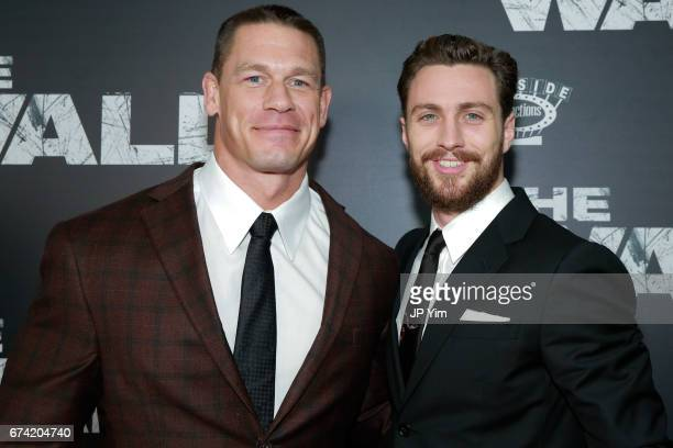 John Cena and Aaron TaylorJohnson attend the premiere of 'The Wall' at Regal Union Square Theatre Stadium 14 on April 27 2017 in New York City