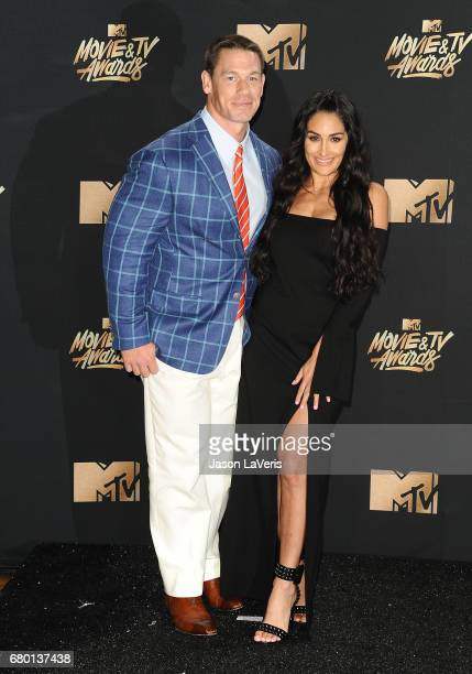 John Cena and Nikki Bella pose in the press room at the 2017 MTV Movie and TV Awards at The Shrine Auditorium on May 7 2017 in Los Angeles California