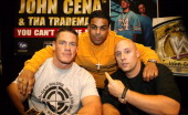 John Cena Cevil and Tha Trademarc during John Cena Signs 'WrestleMania 21' DVD and His Rap CD at FYE May 12 2005 at FYE in New York New York United...