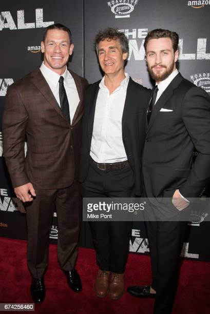 John Cena Doug Liman and Aaron TaylorJohnson attend 'The Wall' World Premiere at Regal Union Square Theatre Stadium 14 on April 27 2017 in New York...